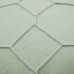 hexagon mint green detail kussen licht groen hinck amsterdam wolvilt 40x60cm woonaccessoires met bijzondere texturen met oog voor detail, handgemaakt en of handgeweven
